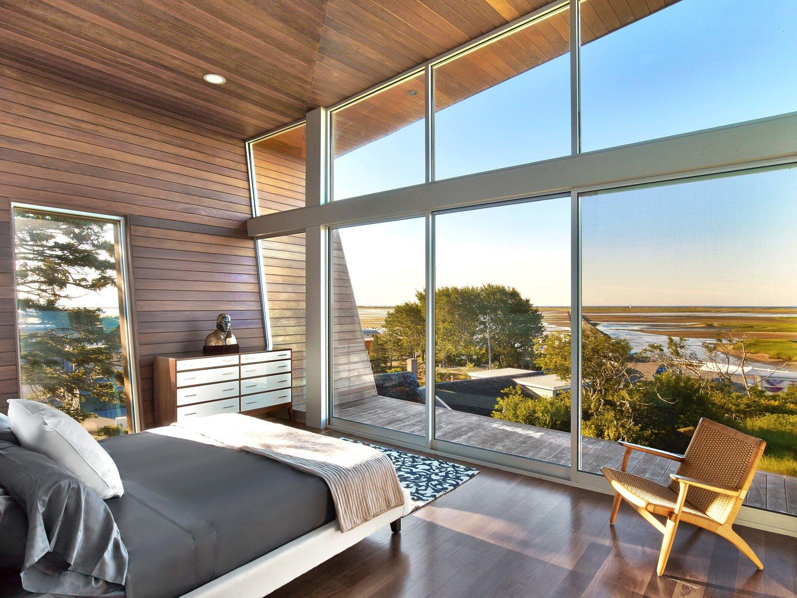 Bedroom, Ceiling Lighting, Chair, Bed, Dresser, and Medium Hardwood Floor  Cape Cod - Beach House by Hariri & Hariri Architecture