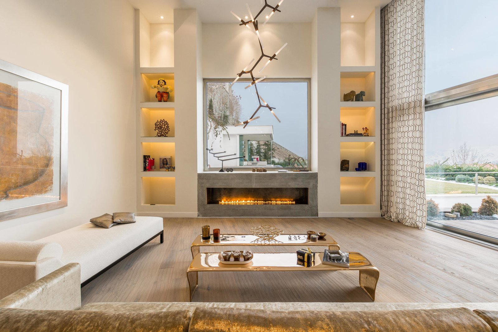 Tagged: Living Room, Sofa, Coffee Tables, Bookcase, Ceiling Lighting, Light Hardwood Floor, and Gas Burning Fireplace.  Lavasan Villa by Hariri & Hariri Architecture
