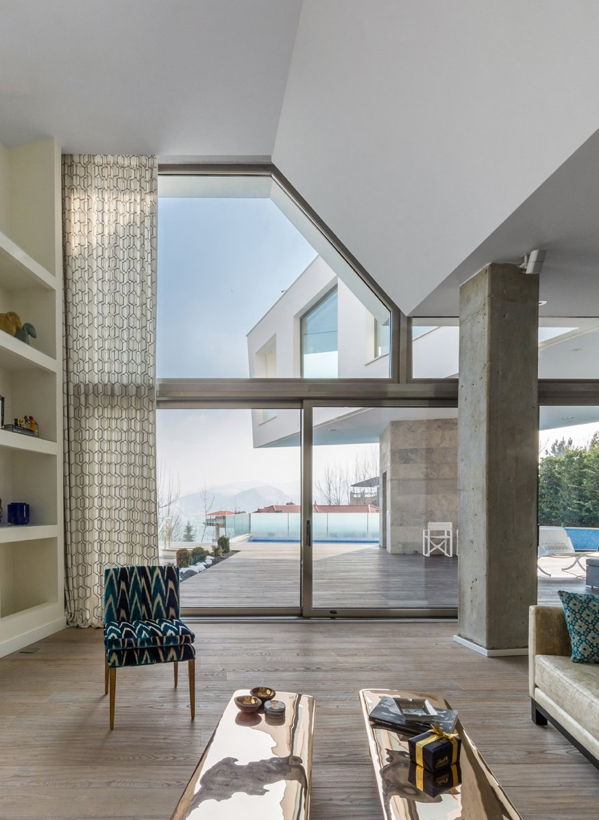 Living Room, Chair, Coffee Tables, and Medium Hardwood Floor  Lavasan Villa by Hariri & Hariri Architecture