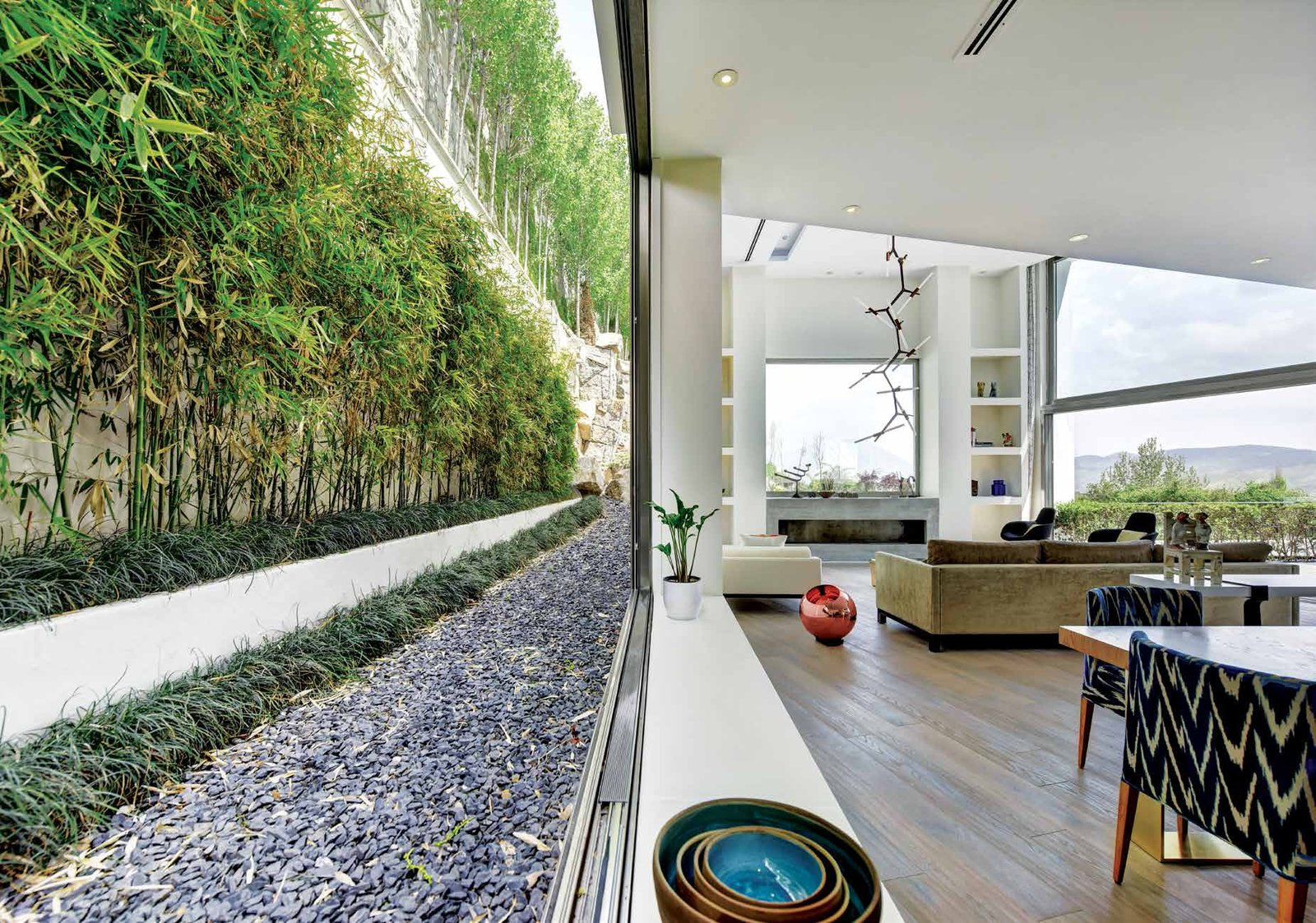 Tagged: Living Room, Sofa, Recessed Lighting, Chair, and Medium Hardwood Floor.  Lavasan Villa by Hariri & Hariri Architecture