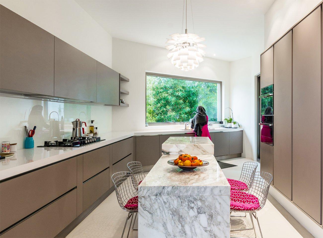 Kitchen, Wall Oven, and Refrigerator  Lavasan Villa by Hariri & Hariri Architecture