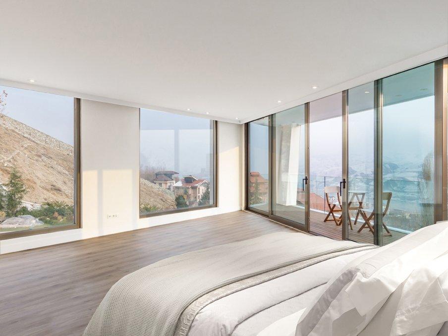 Bedroom, Bed, Ceiling Lighting, and Light Hardwood Floor  Lavasan Villa by Hariri & Hariri Architecture
