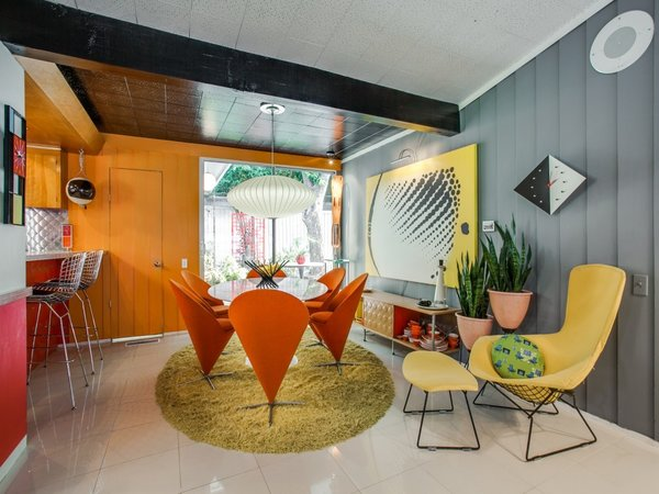 Dining Room, Table, Ceiling Lighting, Ceramic Tile Floor, and Chair  Candy-Colored Mid-Century Modern Throwback
