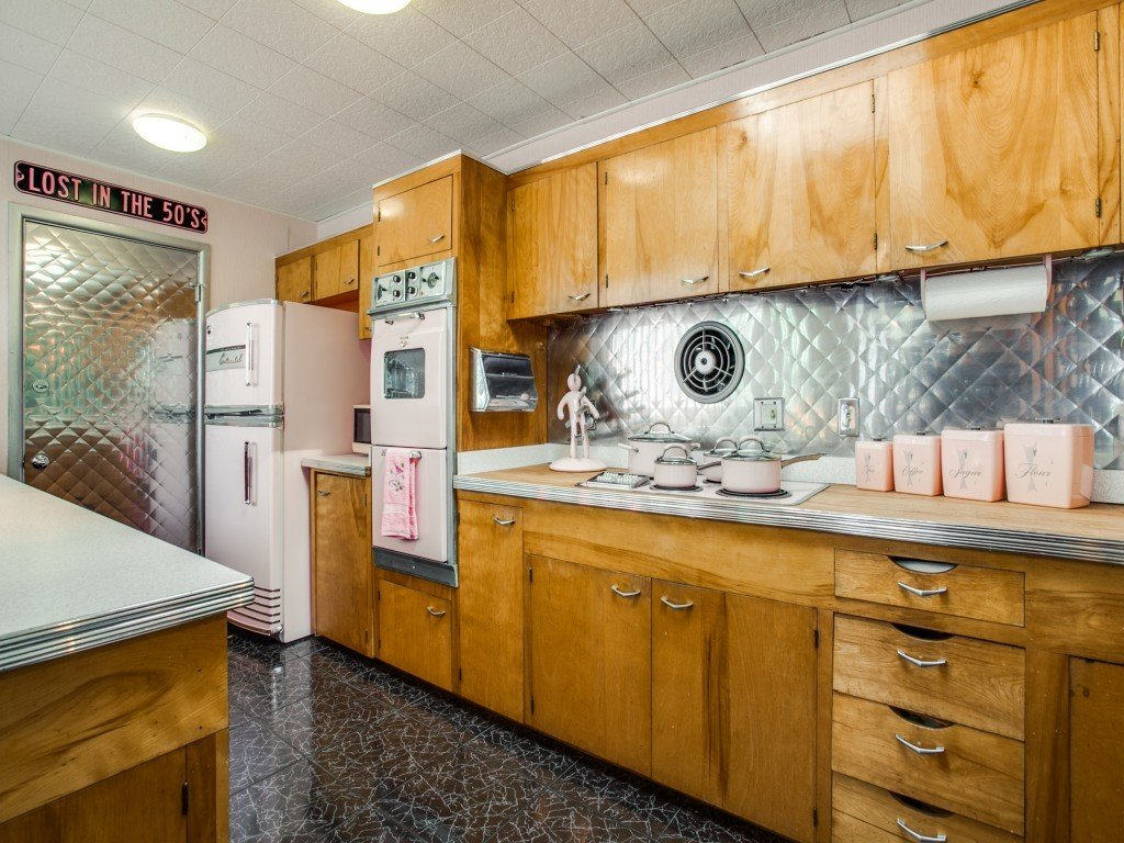 Tagged: Kitchen, Metal Backsplashe, Wood Cabinet, Ceiling Lighting, Wood Counter, and Cooktops.  Candy-Colored Mid-Century Modern Throwback