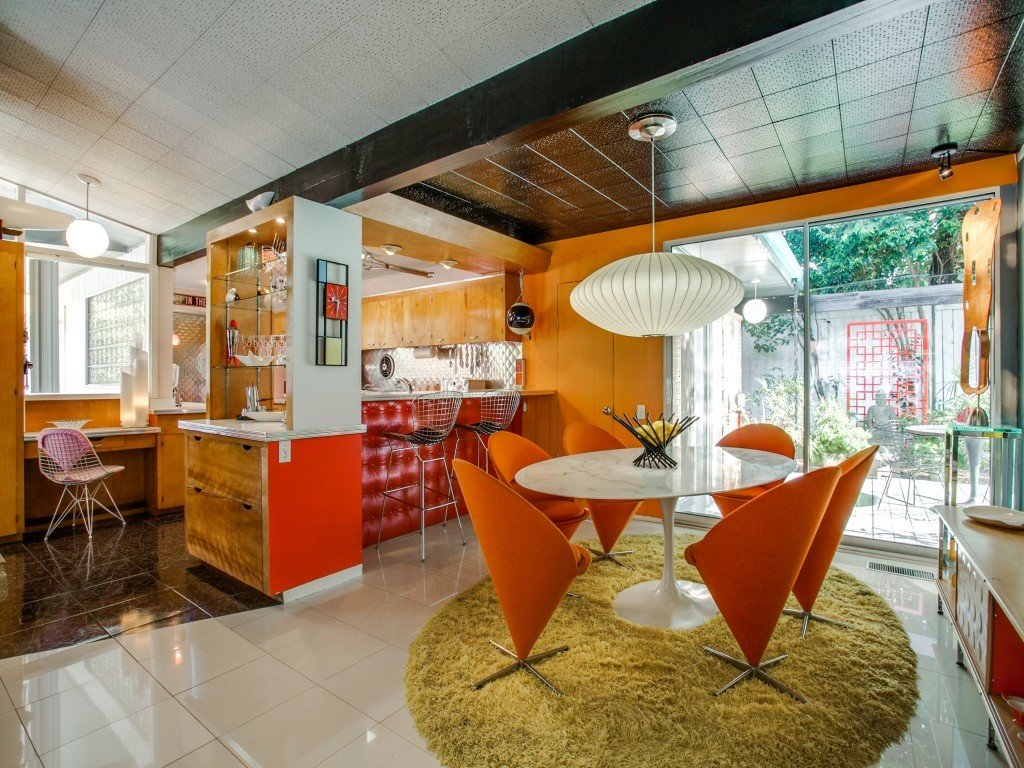 Tagged: Wood Cabinet, Ceiling Lighting, Dining Room, Table, and Chair.  Candy-Colored Mid-Century Modern Throwback