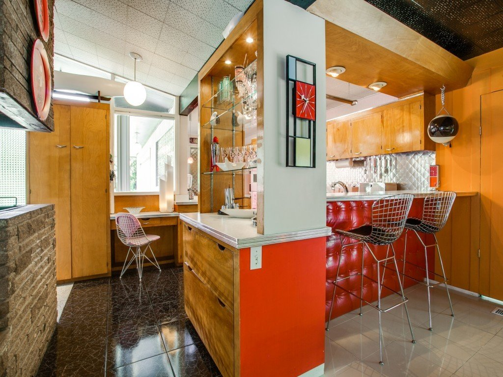 Kitchen, Metal Backsplashe, and Wood Cabinet  Candy-Colored Mid-Century Modern Throwback