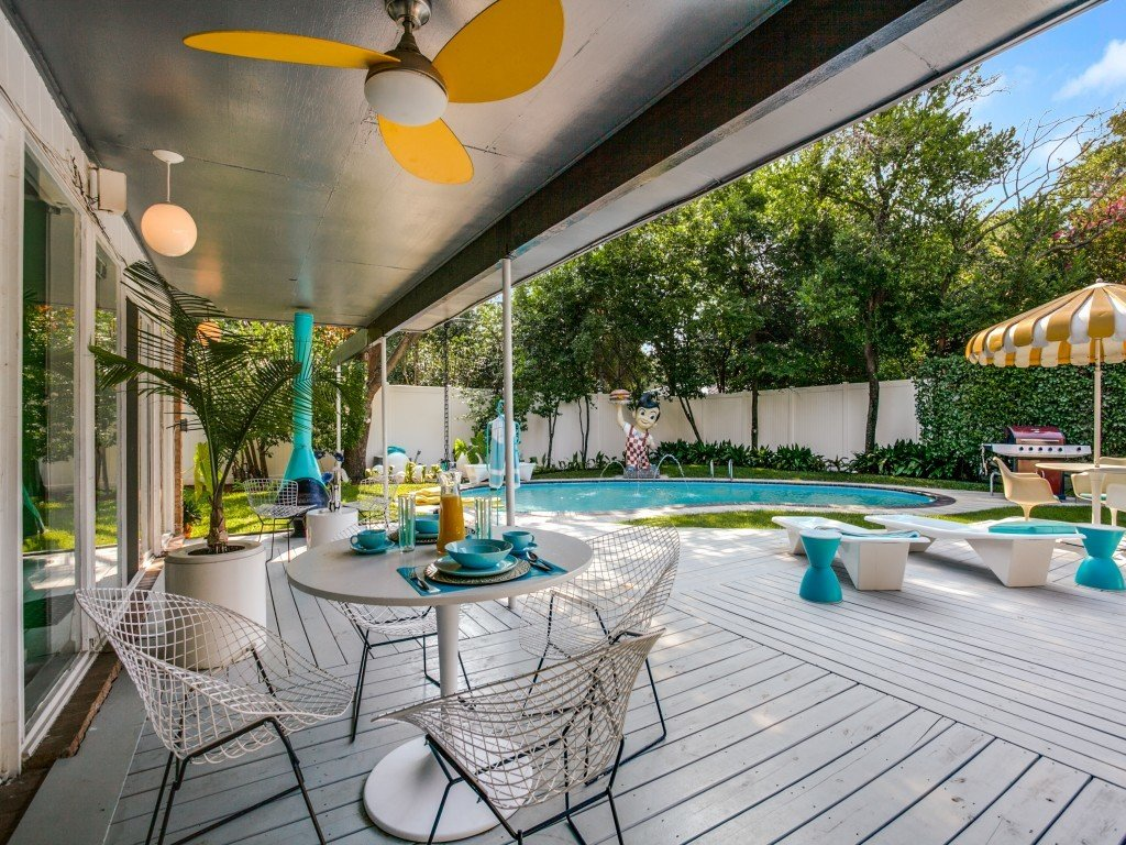 Outdoor, Back Yard, Trees, Grass, Swimming Pools, Tubs, Shower, Large Patio, Porch, Deck, Large Pools, Tubs, Shower, Wood Patio, Porch, Deck, Vertical Fences, Wall, and Wood Fences, Wall  Candy-Colored Mid-Century Modern Throwback