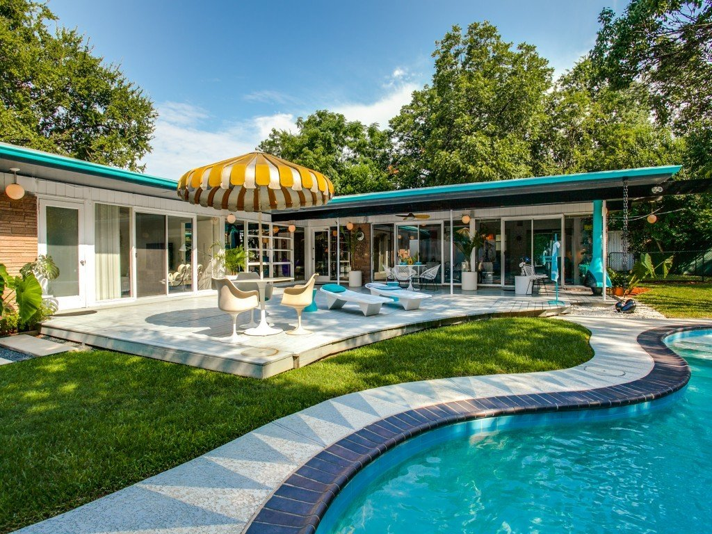 Outdoor, Grass, Back Yard, Trees, Large Pools, Tubs, Shower, Wood Patio, Porch, Deck, Swimming Pools, Tubs, Shower, and Large Patio, Porch, Deck  Candy-Colored Mid-Century Modern Throwback