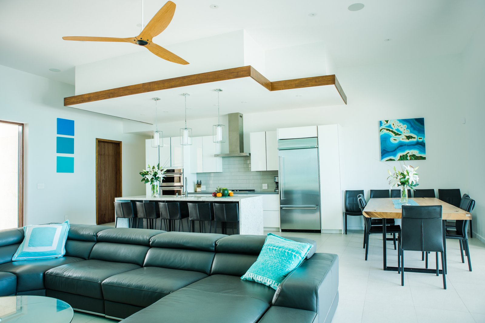 Sofa, Sectional, Kitchen, White Cabinet, Pendant Lighting, and Refrigerator  Tip of the Tail Villa