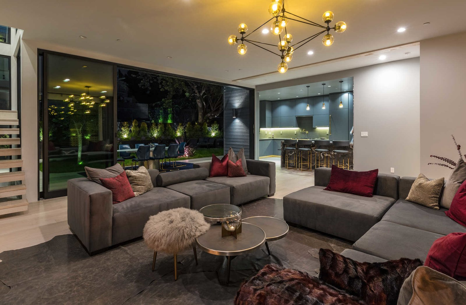 Living Room, Sofa, Coffee Tables, Light Hardwood Floor, Ceiling Lighting, and Sectional  Italian Modernist Home