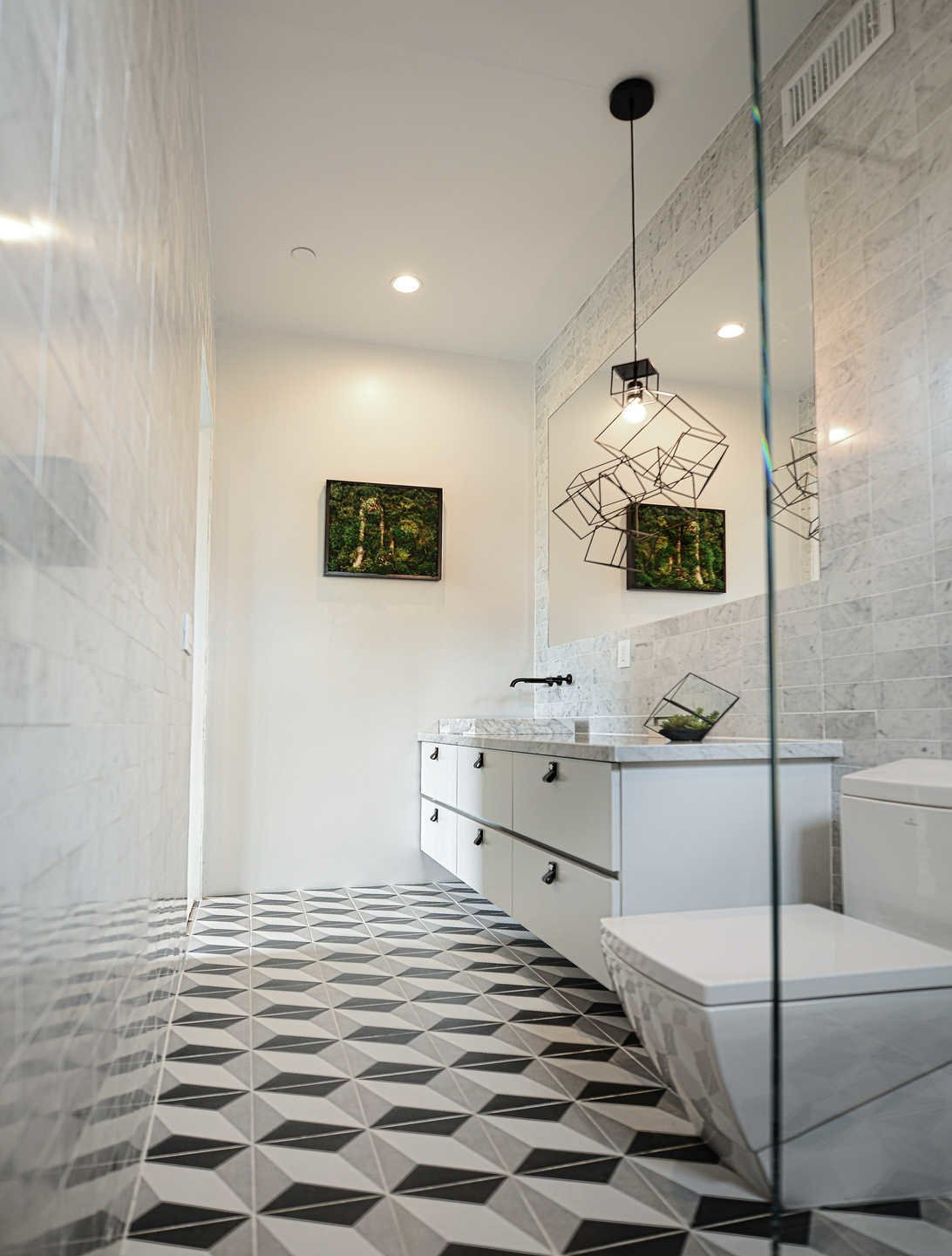 Bath Room, Two Piece Toilet, Pendant Lighting, Stone Tile Wall, Ceramic Tile Floor, and Marble Counter  Italian Modernist Home