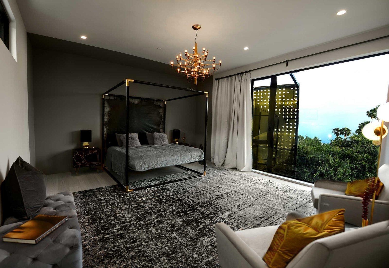 Bedroom, Ceiling Lighting, Lamps, Bed, Bench, and Light Hardwood Floor  Italian Modernist Home