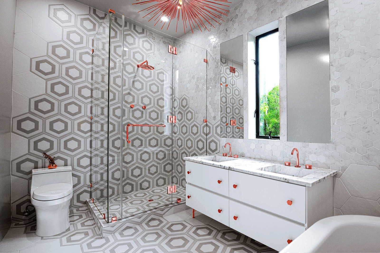 Bath Room, Enclosed Shower, Ceiling Lighting, Drop In Sink, Corner Shower, Ceramic Tile Floor, Marble Counter, Ceramic Tile Wall, and Two Piece Toilet  Italian Modernist Home
