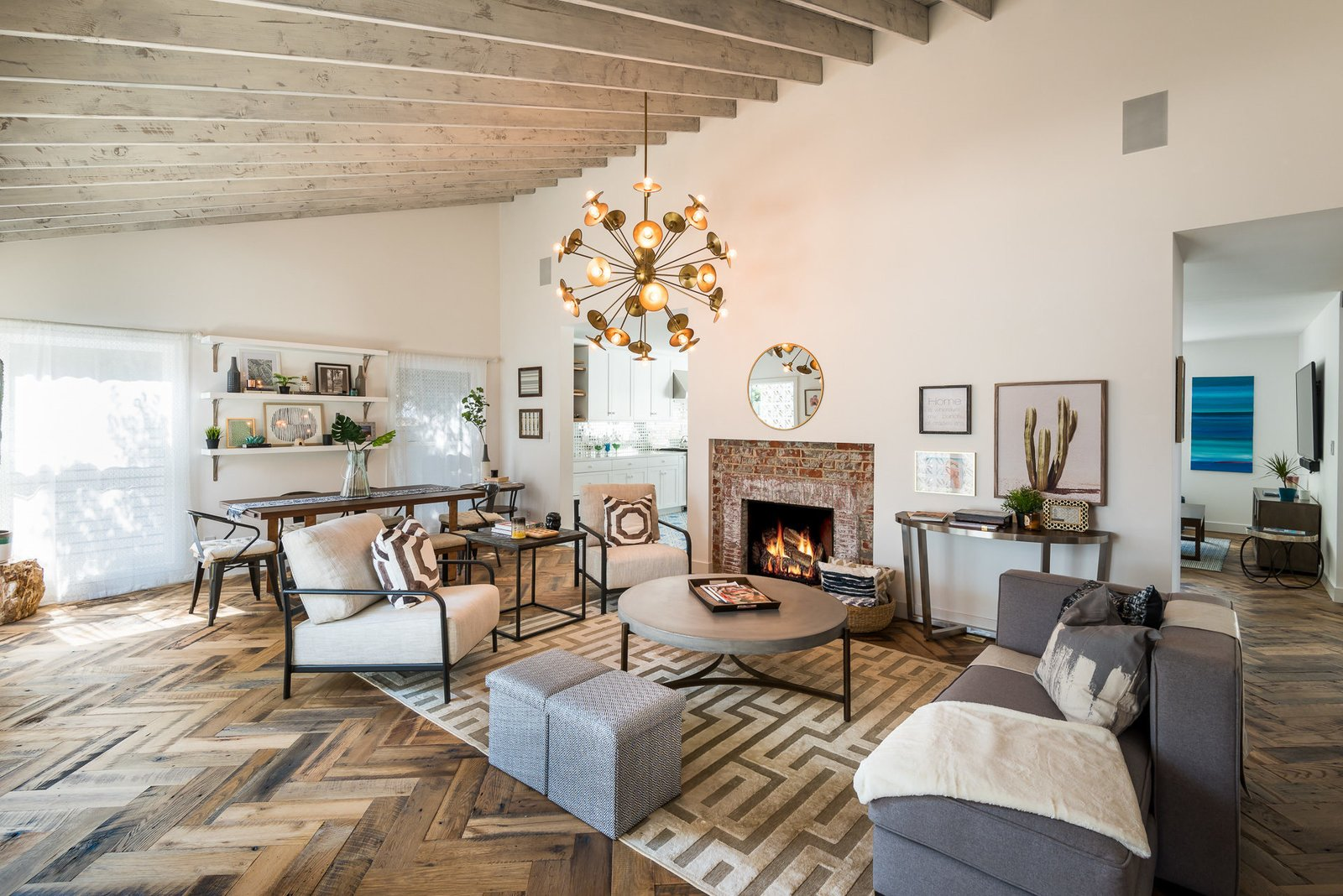 Living Room, Medium Hardwood Floor, Chair, Sofa, and Standard Layout Fireplace  Mid-Century Meets Boho Chic