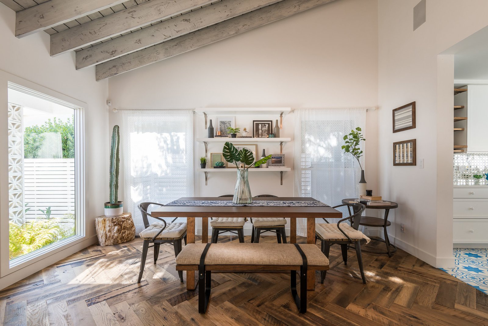 Dining Room, Bench, Table, Medium Hardwood Floor, and Chair  Mid-Century Meets Boho Chic