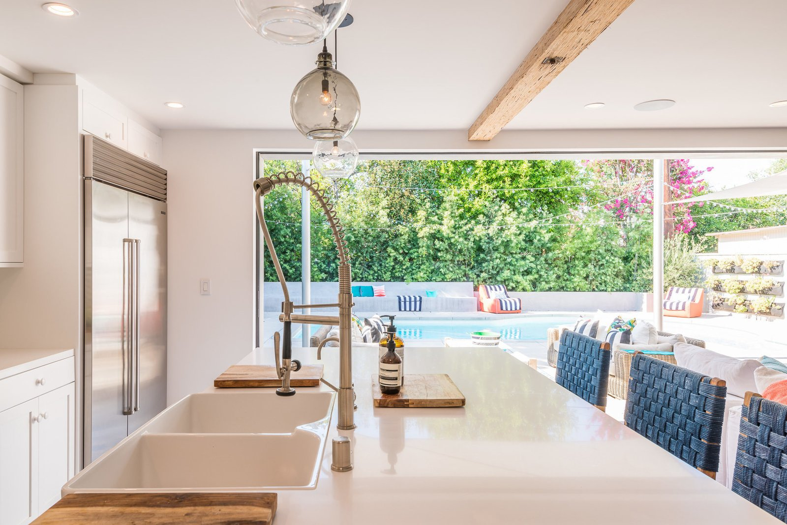 Kitchen, White Cabinet, and Drop In Sink  Mid-Century Meets Boho Chic