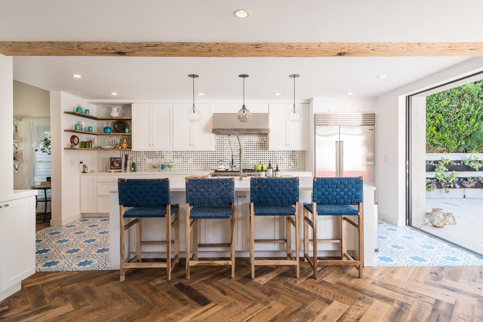 Kitchen, Refrigerator, Range Hood, White Cabinet, and Medium Hardwood Floor  Mid-Century Meets Boho Chic