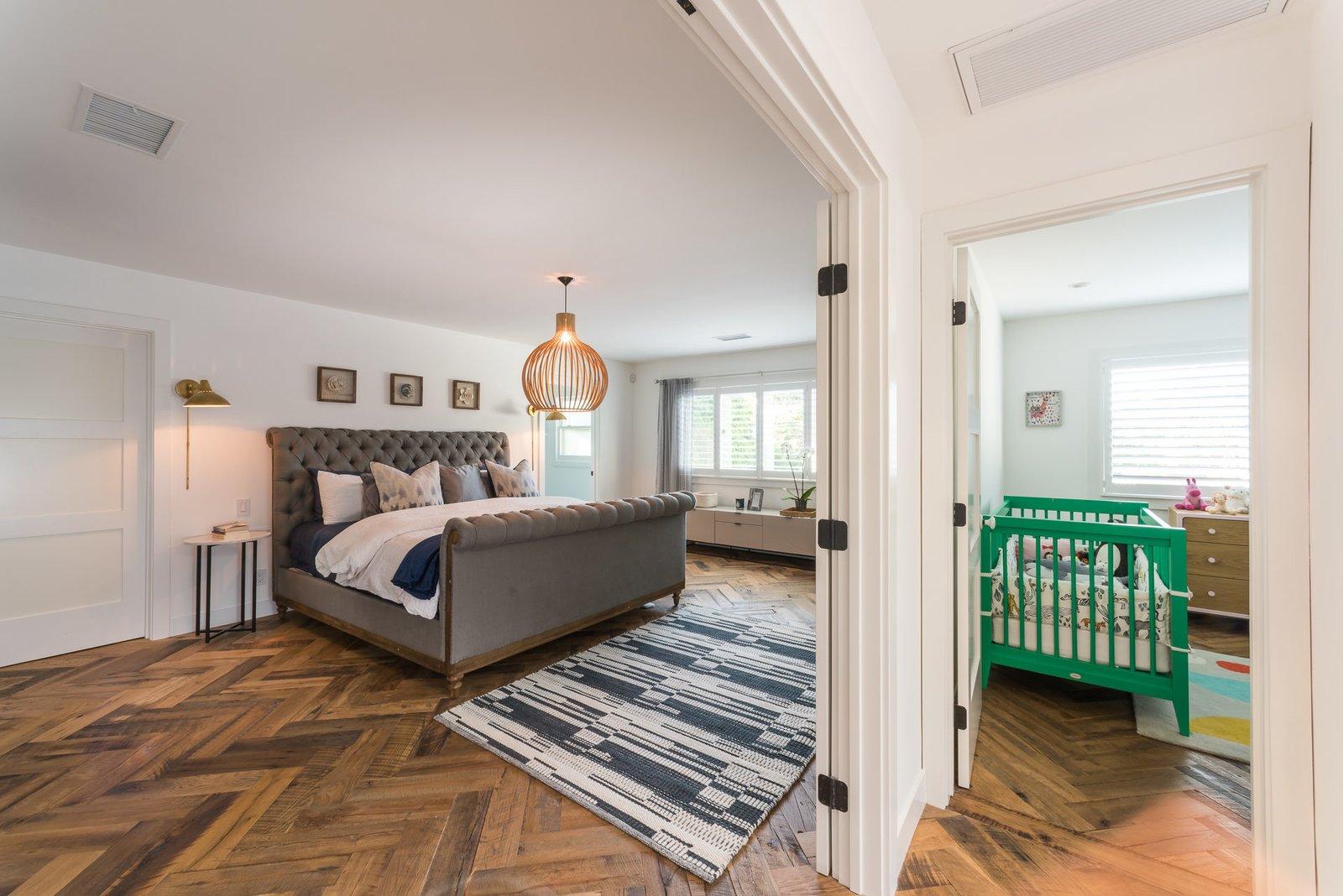 Bedroom, Medium Hardwood Floor, and Bed  Mid-Century Meets Boho Chic