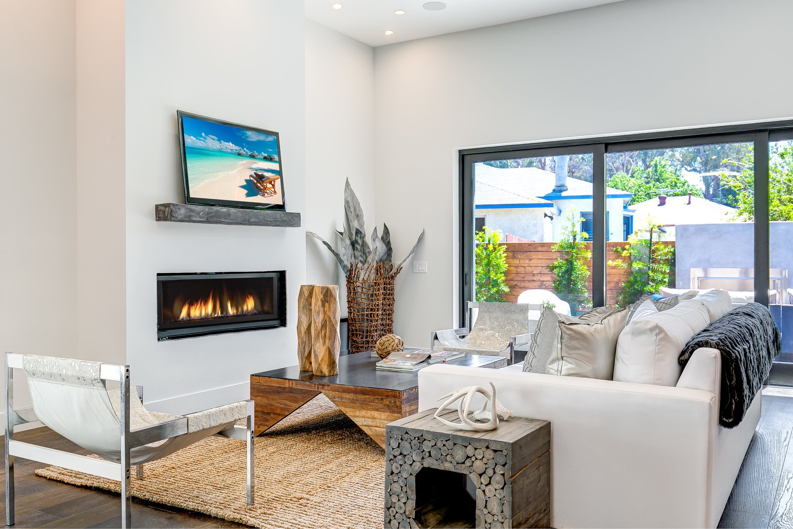 Chair, Sofa, Coffee Tables, End Tables, Medium Hardwood Floor, Rug Floor, Standard Layout Fireplace, Gas Burning Fireplace, Ceiling Lighting, and Office  2701 Armacost