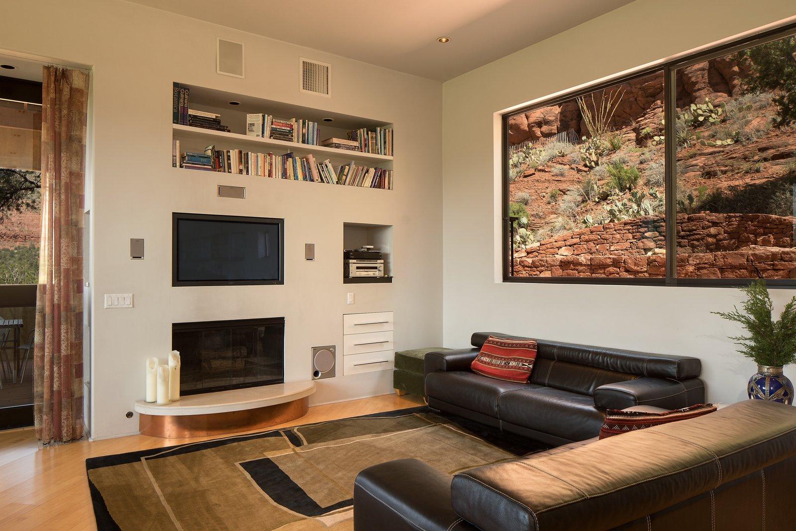 Living Room, Shelves, Sofa, Ceiling Lighting, Light Hardwood Floor, and Standard Layout Fireplace  2945 Red Rock Loop Rd.