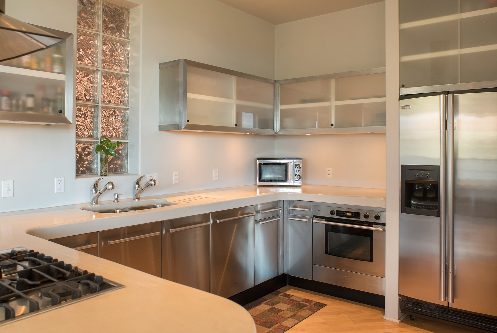 Kitchen, Refrigerator, Cooktops, Microwave, Wall Oven, Light Hardwood Floor, and Drop In Sink  2945 Red Rock Loop Rd.