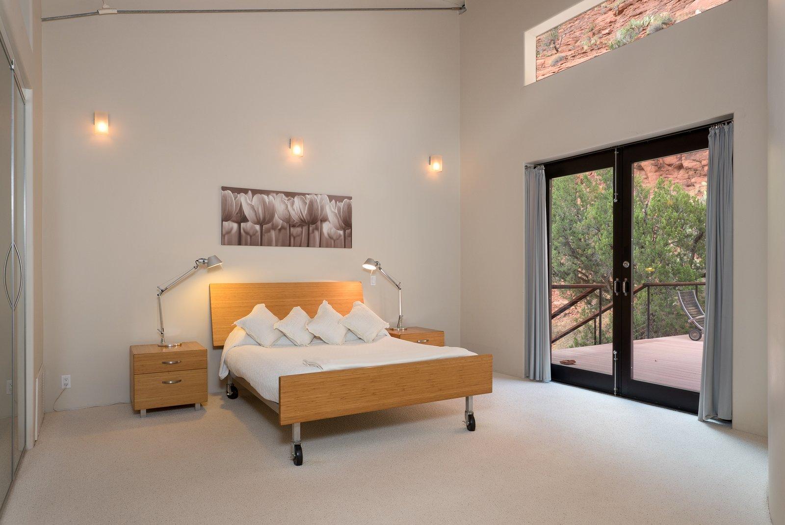 Bedroom, Bed, Lamps, Carpet Floor, Night Stands, and Wall Lighting  2945 Red Rock Loop Rd.