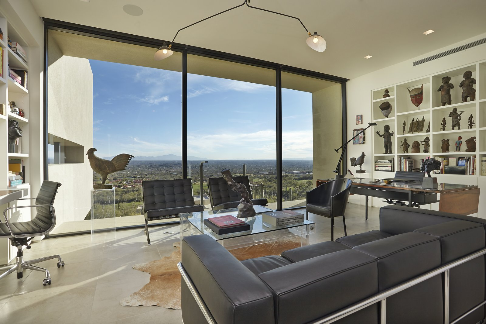 Office, Bookcase, Chair, Storage, Shelves, Desk, Study Room Type, Den Room Type, Limestone Floor, Lamps, and Library Room Type  Sabino Canyon Home by Kevin B Howard Architects