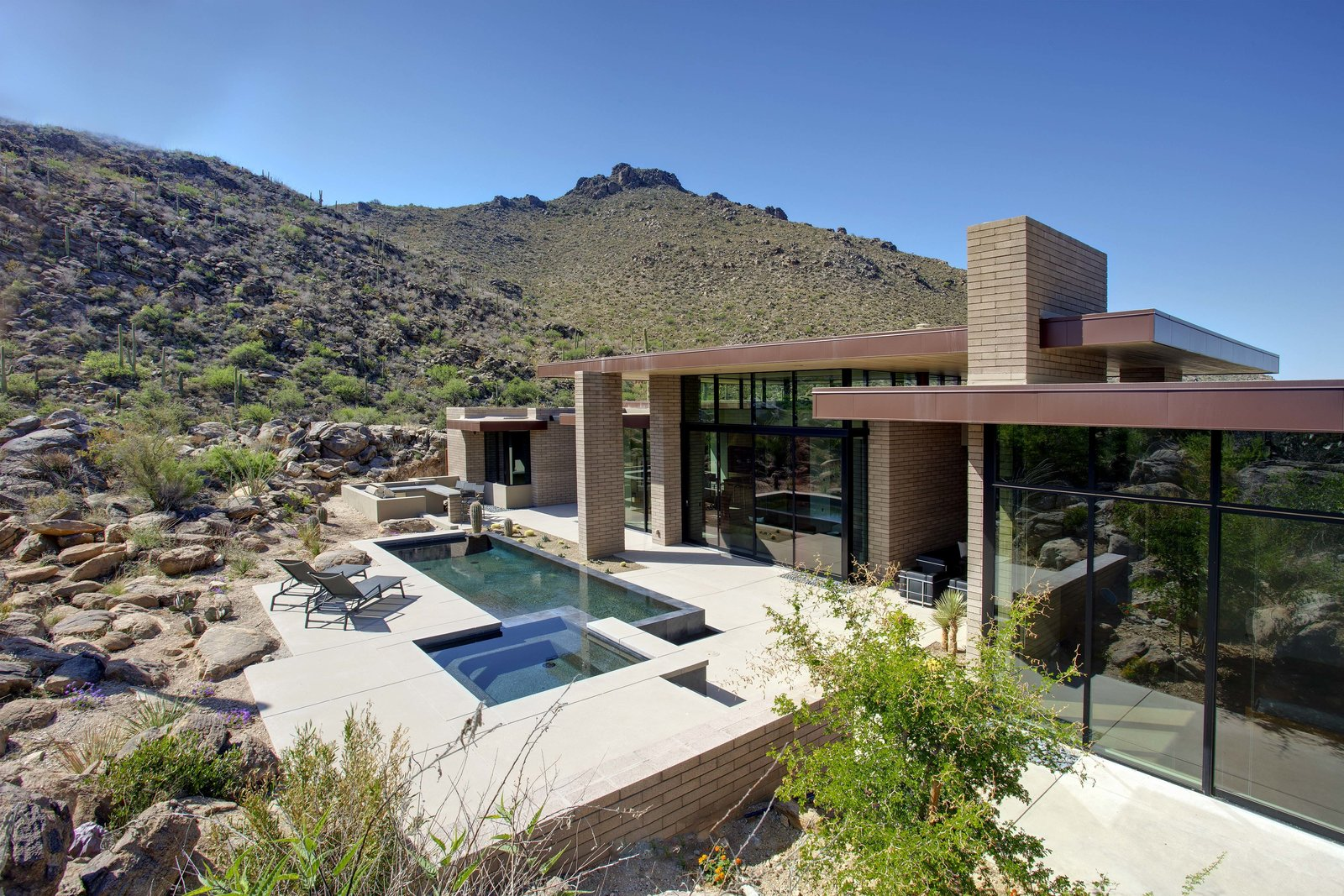 Outdoor, Back Yard, Desert, Small Pools, Tubs, Shower, Boulders, Concrete Patio, Porch, Deck, and Swimming Pools, Tubs, Shower  Desert Mountain Home by Kevin B Howard Architects