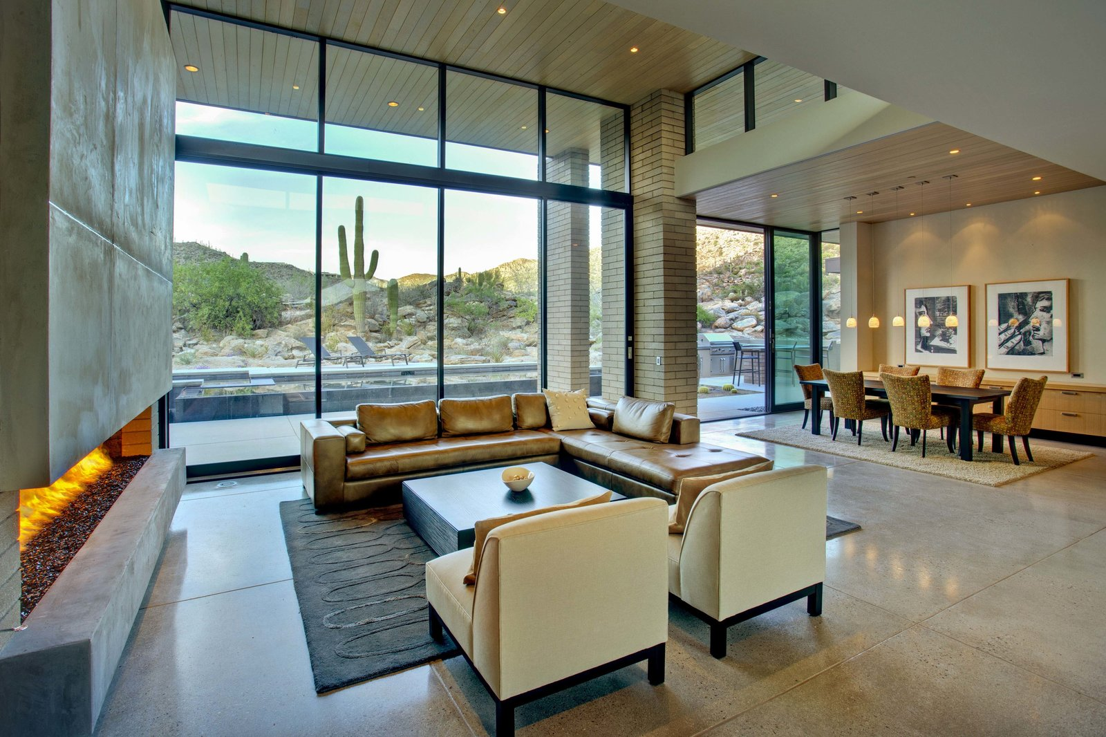 Living Room, Ribbon Fireplace, Recessed Lighting, Gas Burning Fireplace, Concrete Floor, Chair, Sofa, Sectional, and Coffee Tables  Desert Mountain Home by Kevin B Howard Architects