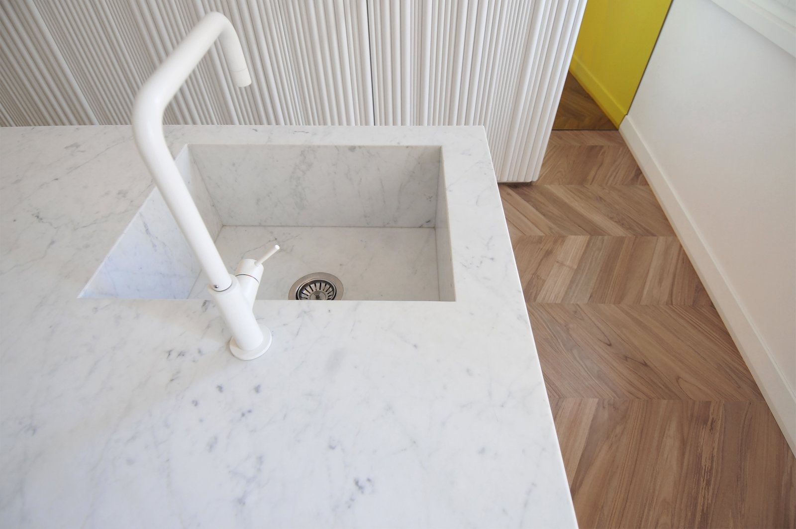 Kitchen, White Cabinet, Light Hardwood Floor, Drop In Sink, and Marble Counter  cdr