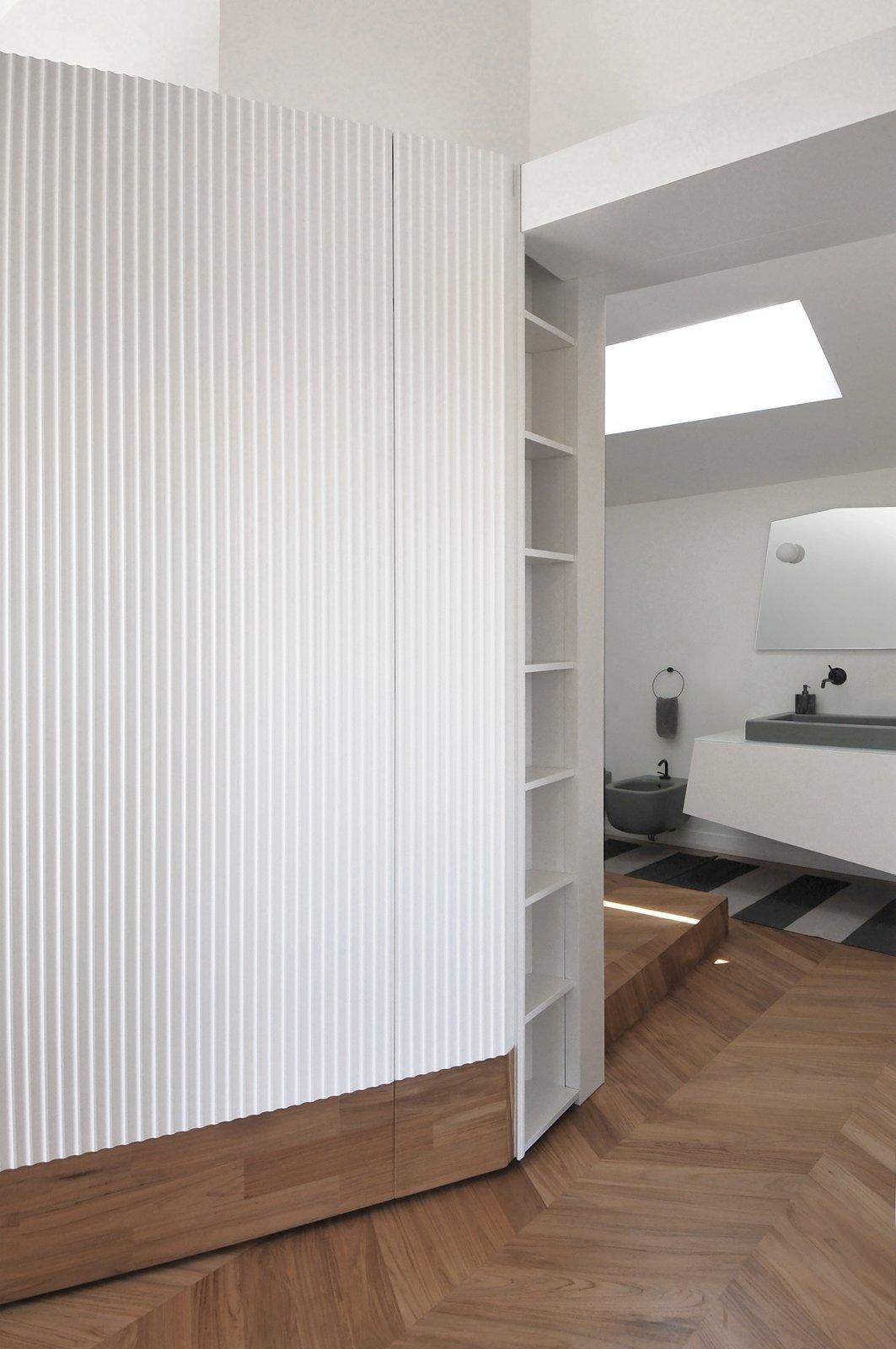 Bath Room, Light Hardwood Floor, Wall Lighting, Drop In Sink, and Two Piece Toilet  cdr