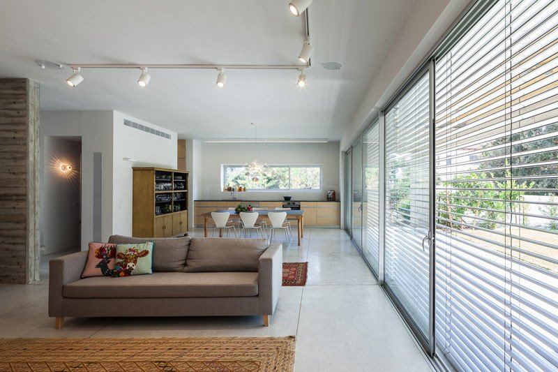Living Room, Sofa, Ceiling Lighting, Track Lighting, Concrete Floor, and Carpet Floor  Urban Life In The Country