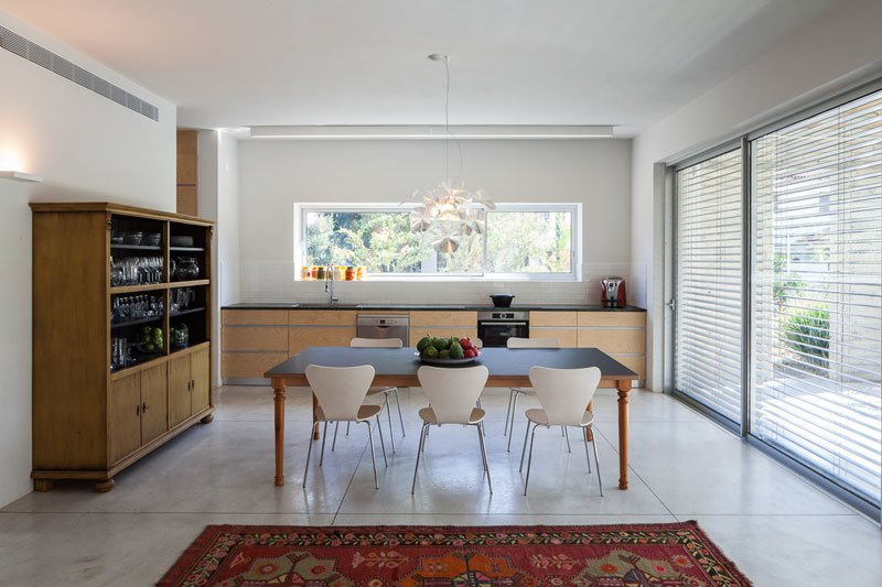 Dining Room, Ceiling Lighting, Storage, Table, Chair, Pendant Lighting, and Concrete Floor  Urban Life In The Country