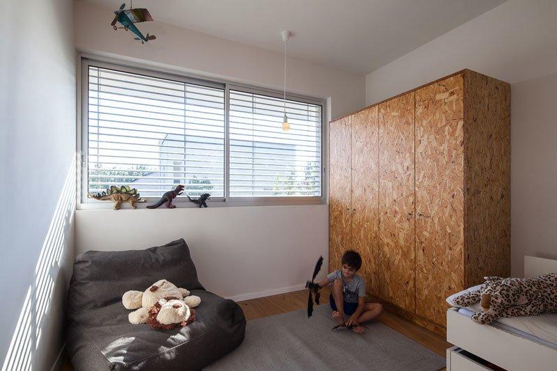 Bedroom, Wardrobe, and Medium Hardwood Floor  Urban Life In The Country