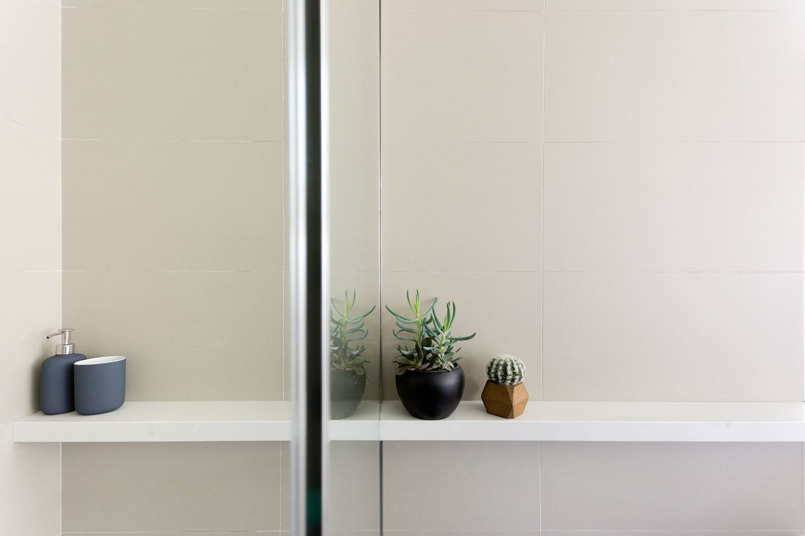 Engineered Quartz Counter, Quartzite Counter, Porcelain Tile Wall, Enclosed Shower, and Outdoor Master Bath Detail Shelf  Photo 7 of 15 in What's the Best Way to Save Space in a Small Bathroom? from Del Rey Residence