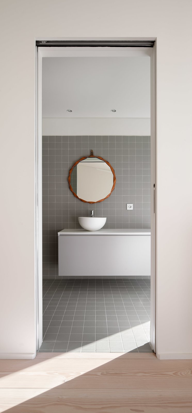 Bath Room, Light Hardwood Floor, Vessel Sink, and Ceramic Tile Floor  The Öcher House by MLMR Architecture Consultancy