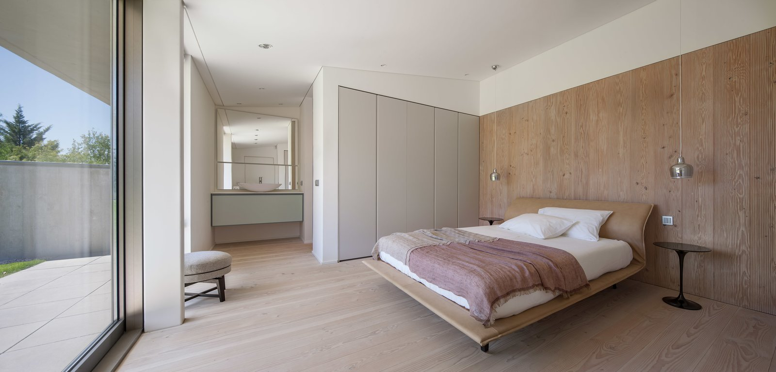 Bedroom, Wardrobe, Bed, Ceiling Lighting, Pendant Lighting, Night Stands, and Light Hardwood Floor  The Öcher House by MLMR Architecture Consultancy