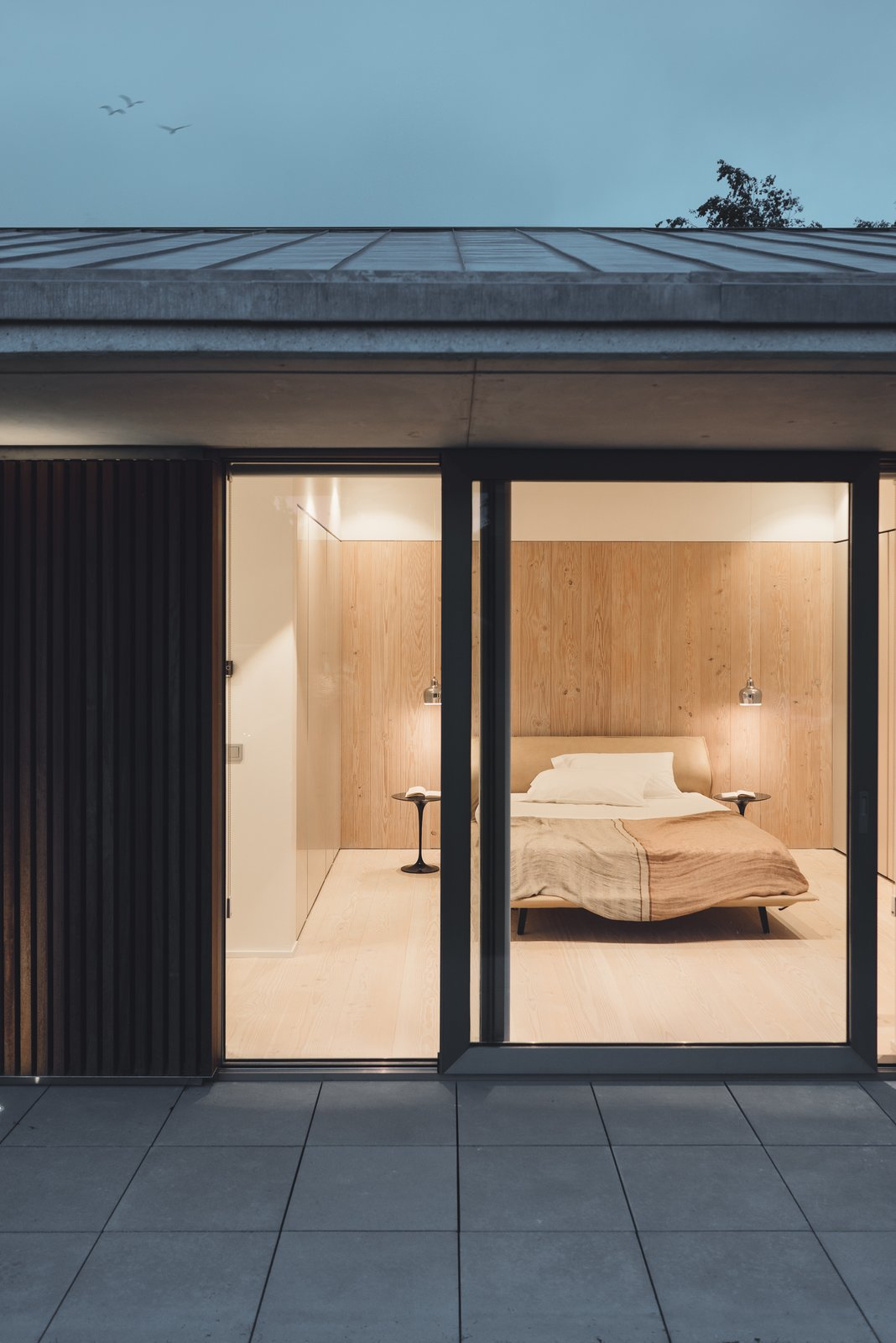 Bedroom, Bed, Night Stands, Pendant Lighting, Ceiling Lighting, and Light Hardwood Floor  The Öcher House by MLMR Architecture Consultancy