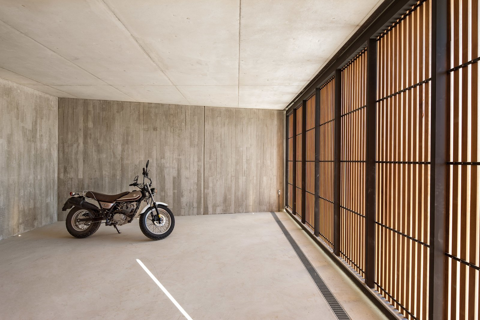 Garage and Attached Garage Room Type  The Öcher House by MLMR Architecture Consultancy