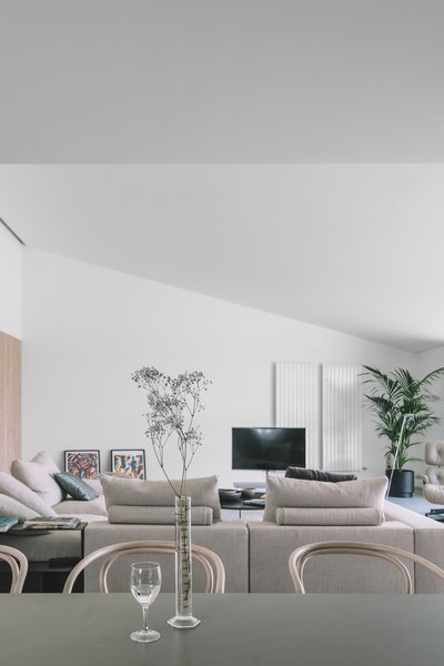 Sofa, Recliner, Ottomans, Chair, Wall Lighting, Dining Room, and Table  The Öcher House by MLMR Architecture Consultancy