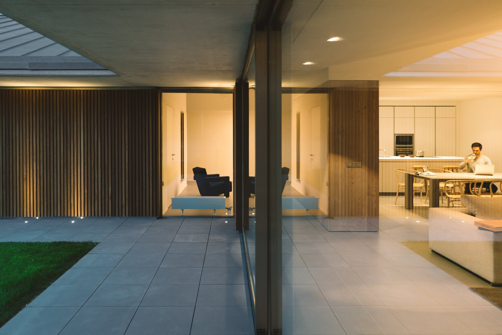 Sofa, Table, Ceiling Lighting, Chair, Outdoor, Front Yard, and Garden  The Öcher House by MLMR Architecture Consultancy