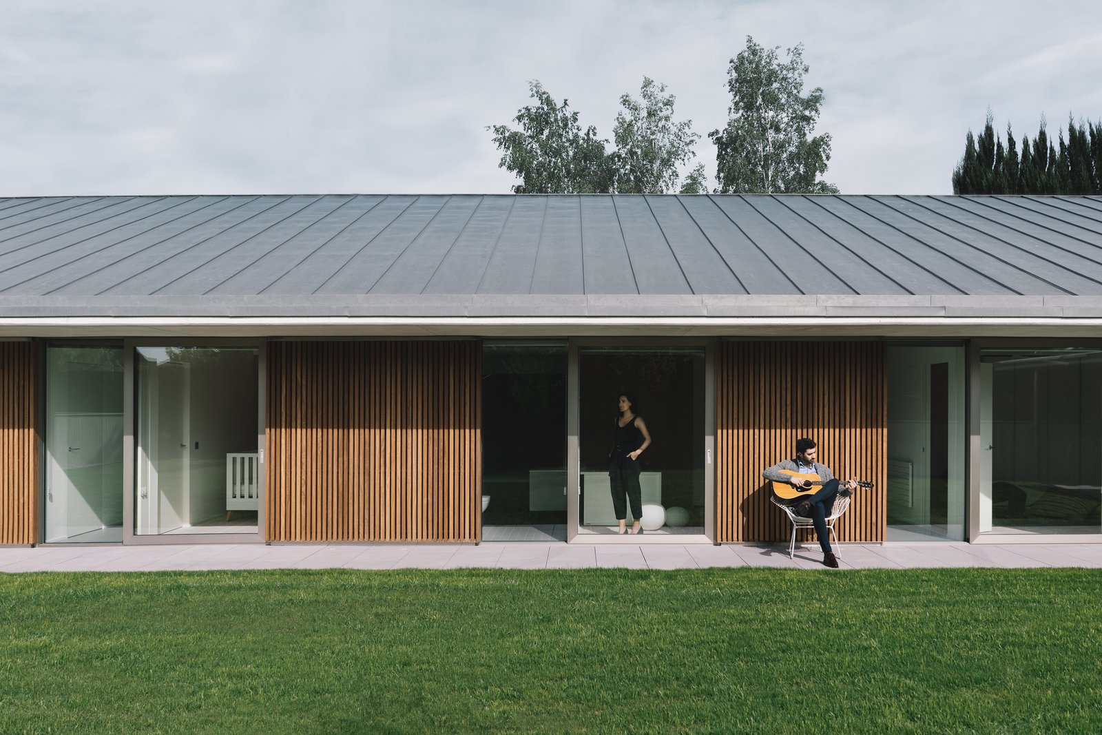 Outdoor, Front Yard, Grass, Garden, Gardens, Metal Patio, Porch, Deck, Wood Patio, Porch, Deck, and Concrete Patio, Porch, Deck  The Öcher House by MLMR Architecture Consultancy