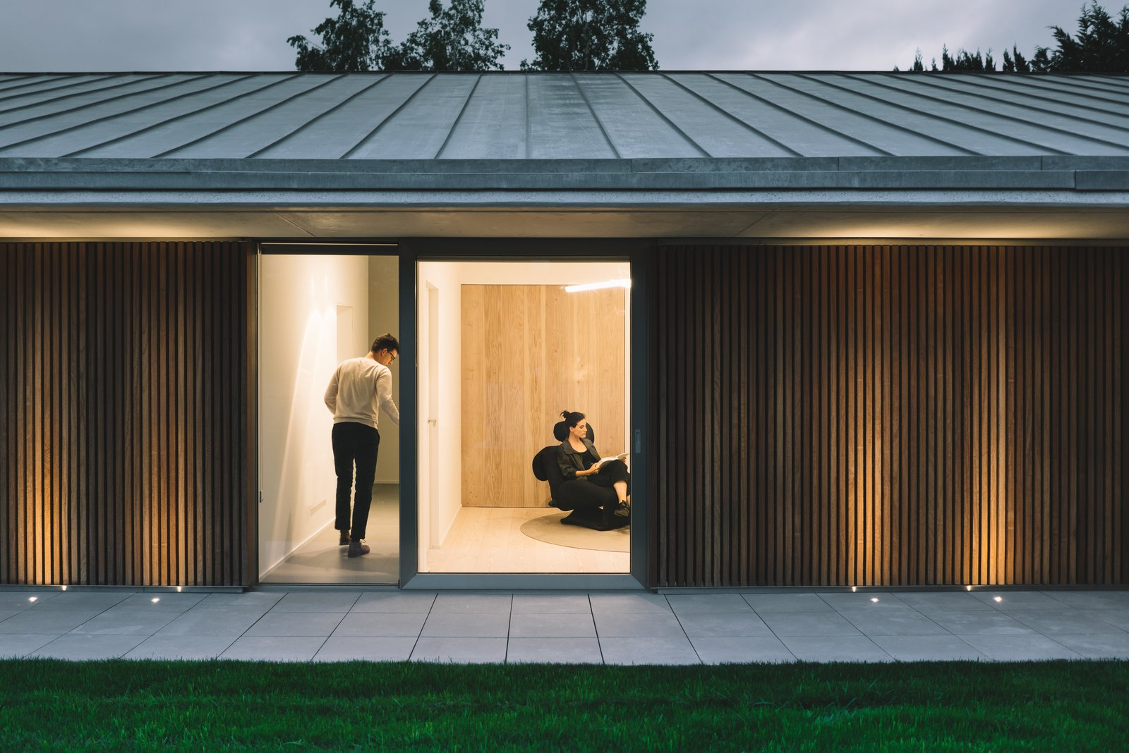 Outdoor, Garden, Front Yard, Grass, Gardens, Wood Patio, Porch, Deck, Metal Patio, Porch, Deck, Post Lighting, and Concrete Patio, Porch, Deck  The Öcher House by MLMR Architecture Consultancy