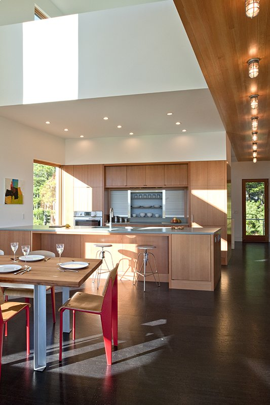 Kitchen, Wood Cabinet, Metal Backsplashe, Cork Floor, Wood Backsplashe, Concrete Counter, Recessed Lighting, Accent Lighting, and Ceiling Lighting  Marsh House by McInturff Architects