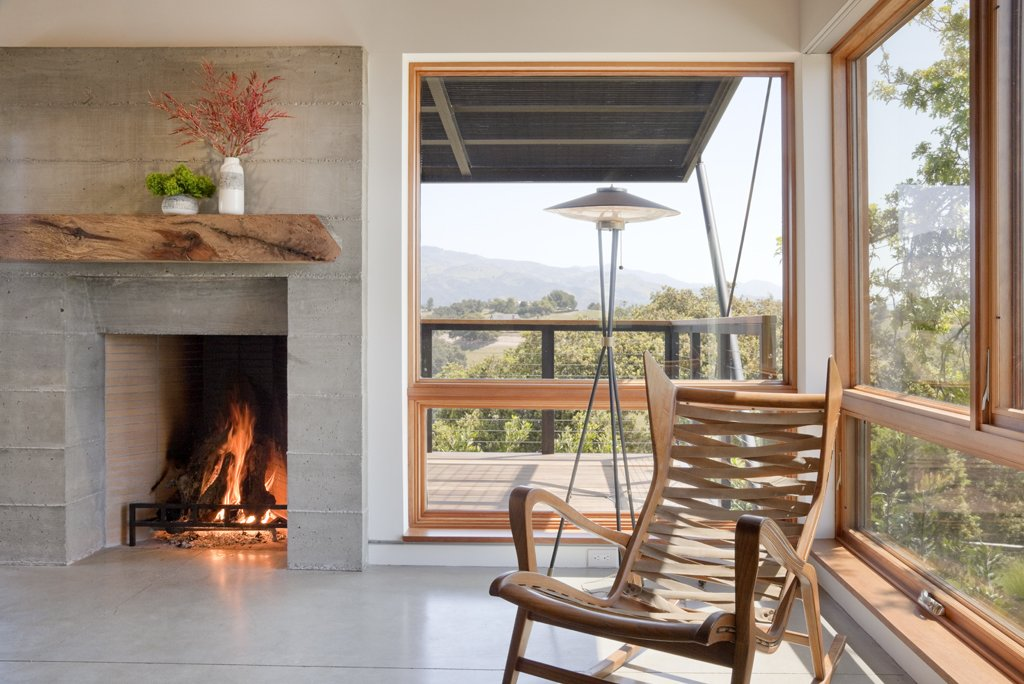 Living Room, Chair, Concrete Floor, Standard Layout Fireplace, Floor Lighting, and Wood Burning Fireplace  Santa Ynez House by Fernau & Hartman Architects