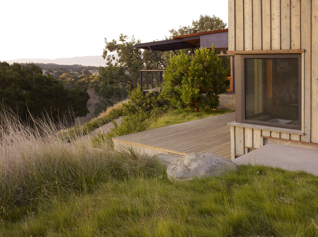 Outdoor, Trees, Back Yard, Shrubs, Grass, Small Patio, Porch, Deck, and Wood Patio, Porch, Deck  Santa Ynez House by Fernau & Hartman Architects