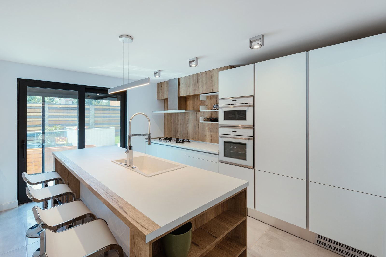 Kitchen, Ceramic Tile Floor, Drop In Sink, and Ceiling Lighting  From Sky to Sea