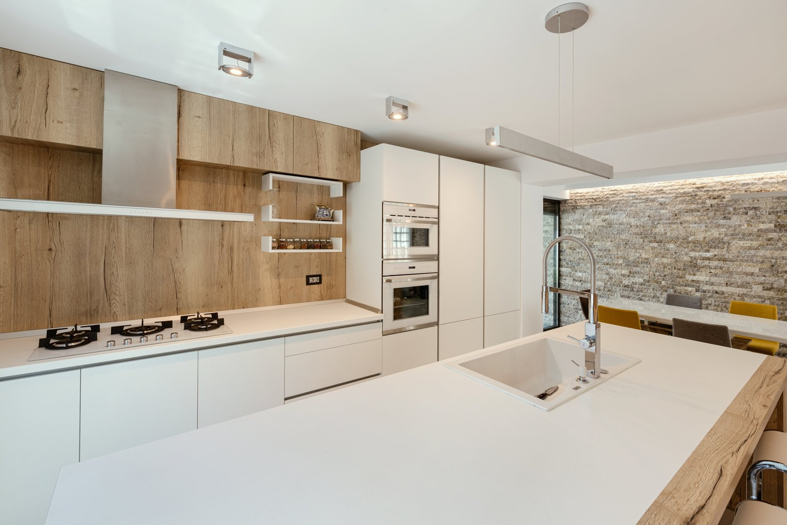 Kitchen, Dishwasher, Refrigerator, White Cabinet, Wall Oven, Ceiling Lighting, Drop In Sink, and Light Hardwood Floor  From Sky to Sea