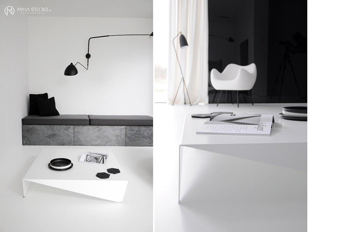 Tagged: Living Room, Coffee Tables, Chair, Wall Lighting, and Floor Lighting.  Minimal Seaside Villa