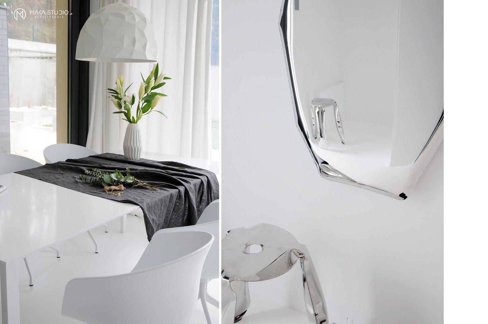 Dining Room, Chair, Table, Pendant Lighting, and Stools  Minimal Seaside Villa